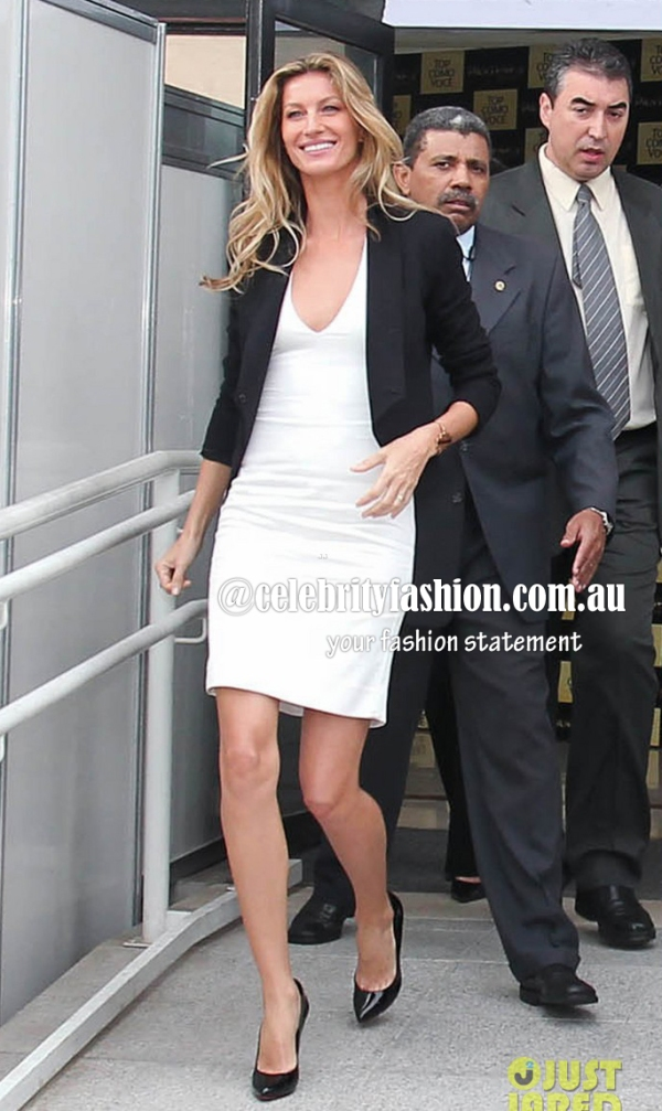 Gisele Bundchen greets her fans after attending the opening of Pantene's Institute Experience in Sao Paulo, Brazil
